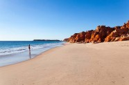 A girl stands at Cape Leveque. Cape Leveque is the northernmost tip of the Dampier Peninsula in the Kimberley region of Western Australia. Cape Leveque is 240 kilometres north of Broome.; Shutterstock ID 777833761