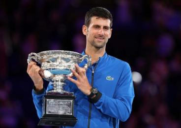 Tennis - Australian Open - Men's Singles Final - Melbourne Park, Melbourne, Australia, January 27, 2019. Serbia's Novak Djokovic poses with his trophy after winning the match against Spain's Rafael Nadal. REUTERS/Lucy Nicholson
